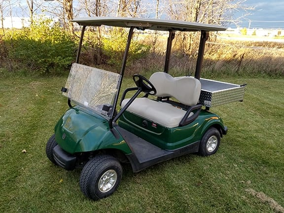 This image has an empty alt attribute; its file name is yamaha-golf-cart.jpg